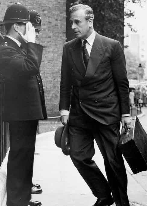A policeman saluting Mountbatten as he arrives at 10 Downing Street in 1956 for the Suez crisis talks (Photo via Getty)