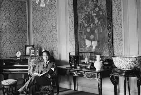 Reading at his residence in France in his youth (Photo by © Hulton-Deutsch Collection/CORBIS/Corbis via Getty Images)