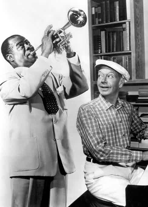 Louis Armstrong rehearsing with Porter on the set of High Society in Los Angeles in 1956 (Photo by Michael Ochs Archive/Getty Images)