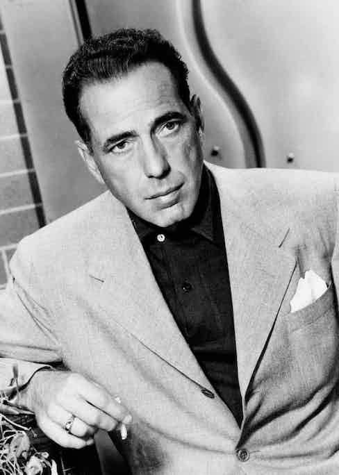 American actor Humphrey Bogart smoking a cigarette circa 1940s