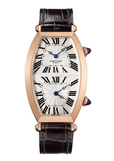 A 2005 example of a Collection Privée Cartier Paris (CPCP): Tonneau Dual Time Zone watch; 15.33mm by 2.9mm, powered by the 9770 MC movment, which features two tiny mechanical movements that can be independently set by the individual corresponding crowns