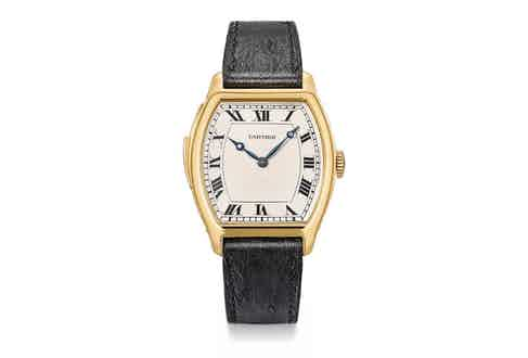 The same Cartier 18K gold tonneau-shaped minute repeating wristwatch, circa 1929, that was auctioned off with Antiquorum in 2002, resurfaced with Christie's in May of 2018 and sold for CHF 312,500; we're able to determine that the two instances of the sale refer to the same watch as the watch and movement numbers can be matched, digit for NO. 22'302, MOVEMENT NO. 40'736 (Image: Christies.com)