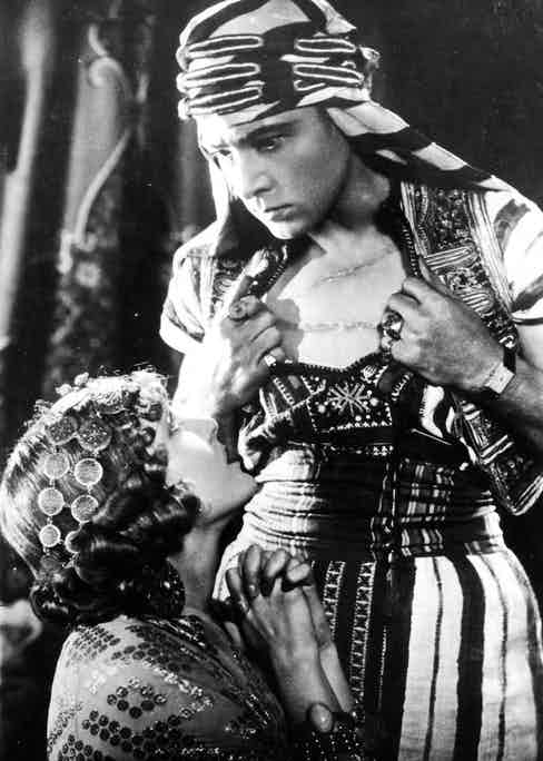 Vilma Banky and Rudolph Valentino in the 1926 film, Son of the Sheik; Valentino insisted on wearing his treasured Cartier Tank during the filming. In every scene. The issue with his decision is that the Tank is not a timepiece that would've a reality in the period in which the film is based