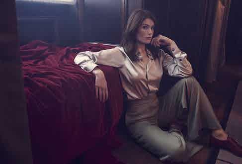 Silver satin shirt, Connolly; sage twill wool-blend wide-leg trousers, Caroline Andrew; tan leather double-monk strap shoes, Crockett & Jones. Rings, property of Gemma Arterton