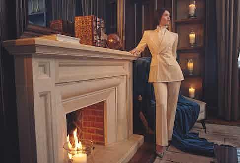 Cream gabardine double-breasted bespoke suit, Edward Sexton; white silk chiffon ruffle shirt, Emma Willis; black evening slingback Peonia, René Caovilla