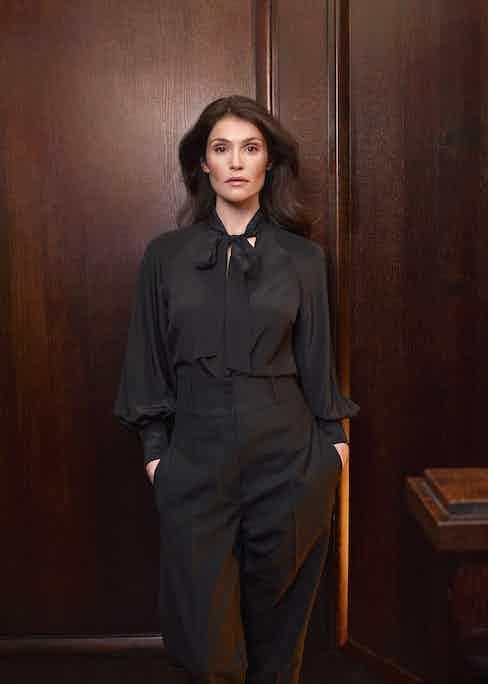 Black pussy-bow silk shirt, Zimmerman at Matches Fashion; black Medea high-rise wool grain de poudre trousers, Roksanda at Matches Fashion