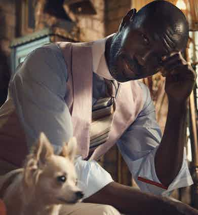 Blue cotton cutaway collar shirt, Udeshi at The Rake; multicolour silk striped tie, Tie Your Tie at The Rake; pink linen double-breasted waistcoat, Favourbrook; cream wool pleat front trouser, Ralph Lauren.