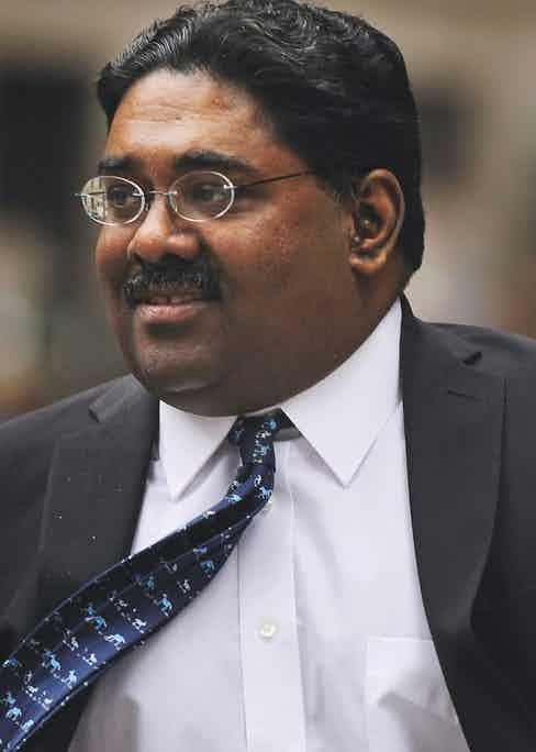 Rajaratnam enters a Manhattan court while on trial for insider trading in 2011 (Photo by Spencer Platt/Getty Images)