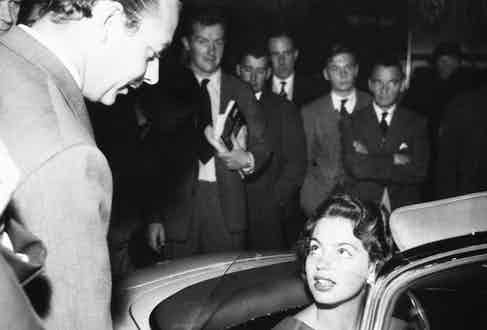In a Mercedes at the International Motor Show at Earl's Court in London, 1957 (Photo by Paul Popper/Popperfoto via Getty Images/Getty Images)