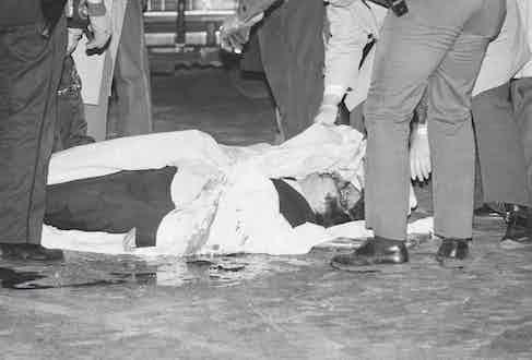 Paul Castellano lies dead on the floor in December 1985 (Photo via Getty)