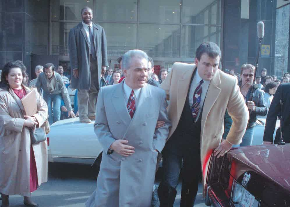 John Gotti being escorted through crowd (Photo via Getty)