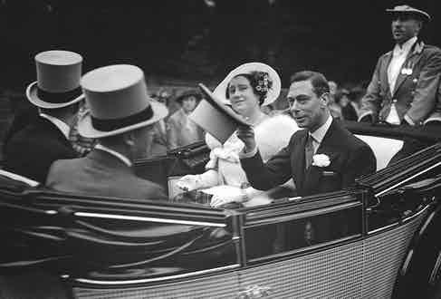 King George VI and Queen Elizabeth (later the Queen Mother) ride in their carriage on Royal Hunt Day at Ascot races (Photo by Popperfoto/Getty Images)