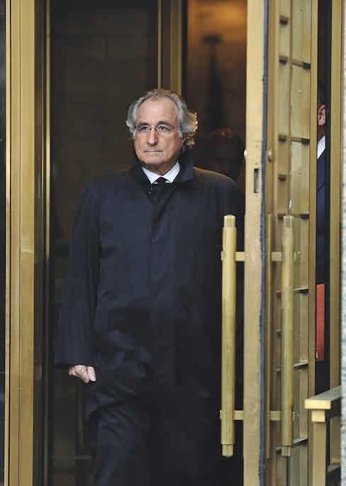 Bernie Madoff leaves a U.S. court in 2009