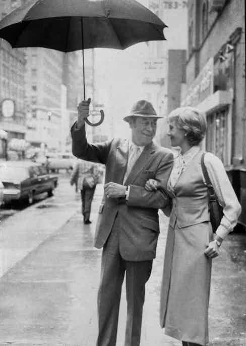 Rex Harrison holds an umbrella for Julie Andrews in 1979 (Photo by Richard Corkery/NY Daily News Archive via Getty Images)