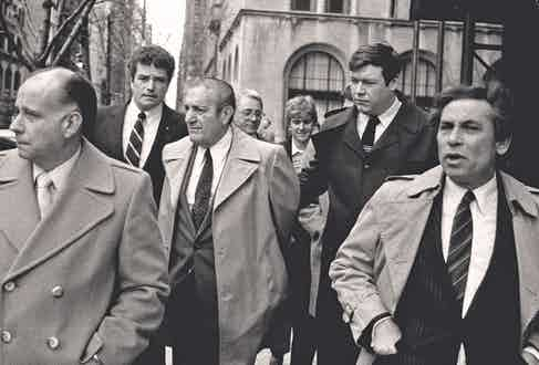 Paul Castellano, former mob boss, who Gotti had killed, is escorted by FBI agents following his surrender in 1984 (Photo by Thomas Monaster/NY Daily News Archive via Getty Images)