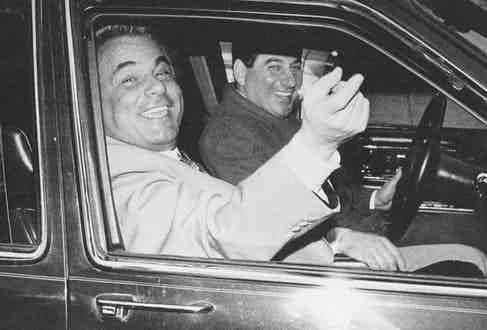 Gotti, elated and acquitted of assault and conspiracy, with his driver in New York, 1986. (Photo by NY Daily News Archive via Getty Images)