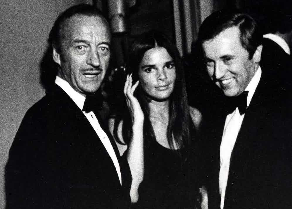 David Niven with Ali MacGraw and David Frost, 1971 (Photo by Ron Galella/WireImage)