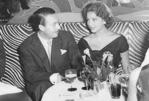 Ira and Alfonso photographed on the famous zebra-print banquettes at El Morocco, New York.