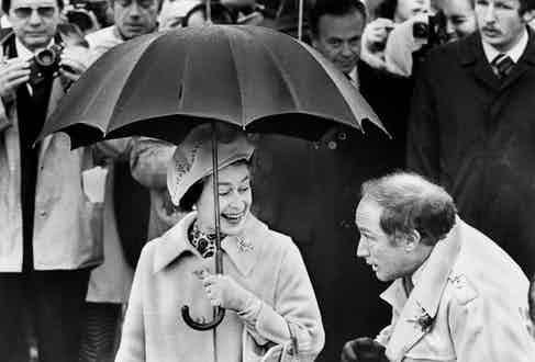 The Queen appears to be asking Canadian Prime minister Pierre Trudeau to share her umbrella in 1977 (Photo by Jeff Goode/Toronto Star Via Getty Images)
