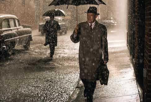 Tom Hanks wearing a mackintosh-style coat in Bridge of Spies, 2015.