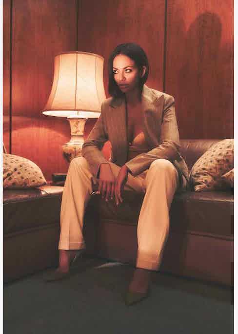 Grey wool Astor jacket and White Wool blend Andela trousers, Ralph Lauren Purple Label; Pink Silk bra, La Perla; Green suede pumps, Manolo Blahnik.