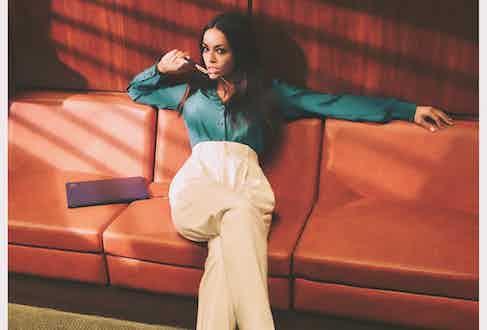 Teal Silk shirt, Caroline Andrew; White Wool blend Andela trousers, Ralph Lauren Purple Label; Black evening Peonia slingback, Rene Caovilla.