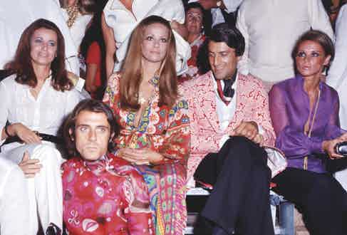 With French actress Claudine Auger and designer Nino Cerruti, circa 1970