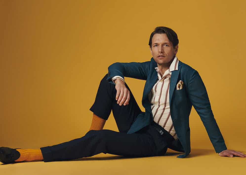 Teal wool unlined single-breasted patch pocket jacket, Sacco; White and brown stripped cotton collar shirt, Tintoria Mattei 954; Yellow and orange bouquet linen pocket square; Calabrese 1924; Navy line Hollywood trouser, Edward Sexton; Yellow cotton sock, London Sock Company; Black calf sagan grand tassel loafer, Baudoin & Lange.