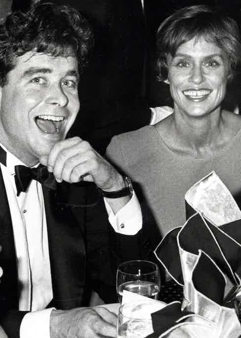 """Jay McInerney and Lauren Hutton during """"Hooray For Hollywood"""" AIDS Benefit  at Bloomingdale's in New York City, 1988 (Photo by Ron Galella/WireImage)"""
