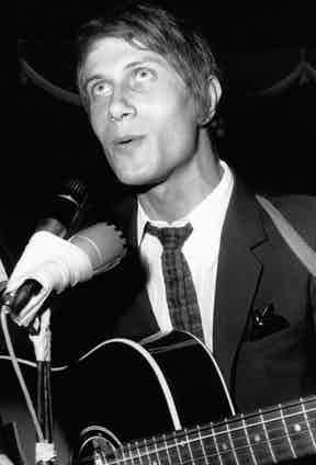 A suited Dutronc mid-song in 1966 (Photo by Keystone-FranceGamma-Rapho via Getty Images)