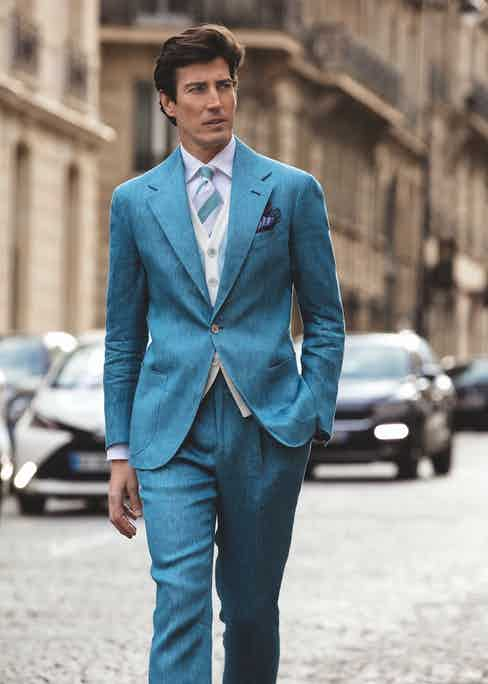 Riviera: Light blue sport jacket; light blue sport trousers; white sport shirt with one-piece collar; light blue knitted cotton waistcoat; turquoise and white club silk tie; blue and purple floral pocket-square; beige suede loafers.