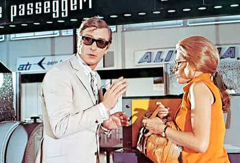 Michael Caine sporting a pair of Curry & Paxton sunglasses, opposite Maggie Blye in The Italian Job (1969) (Photo by Everett Collection / Rex Features (682788r)