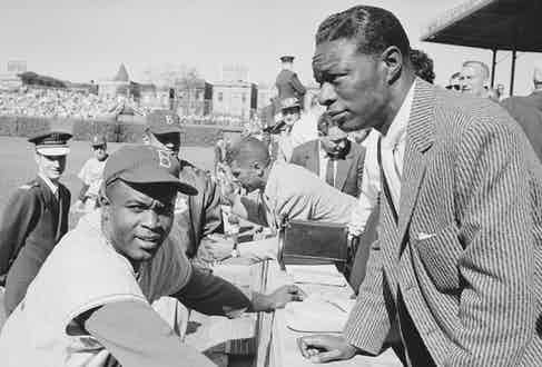 Speaking to Jackie Robinson at Wrigley Field in Chicago, 1954