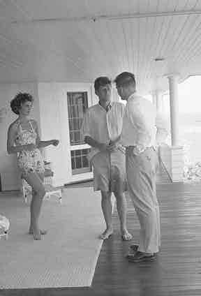 J.F.K. and fiance Jacqueline Bouvier are interviewed for a LIFE Magazine story in Hyannis Port, Massachusetts, 1953 (Photo by Hy Peskin/Getty Images)