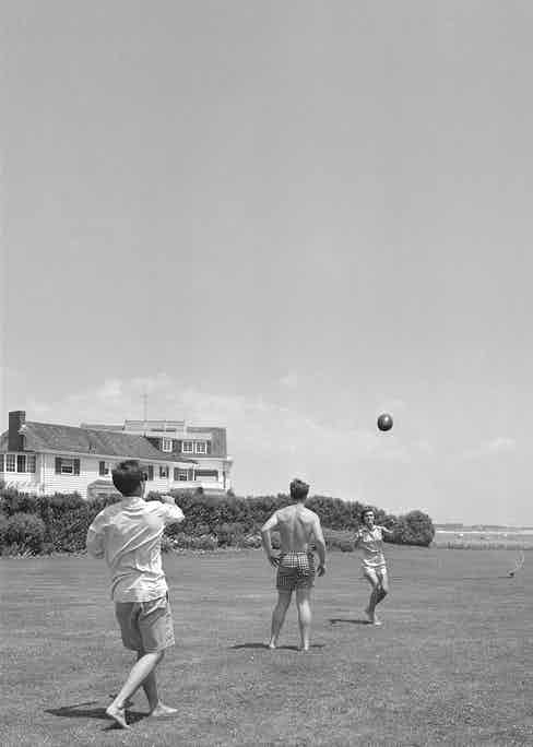 J.F.K. and his then fiancée, Jacqueline Bouvier, play American football at his house in Hyannis Port, 1953 (Photo by Hy Peskin/Getty Images)