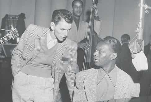Speaking to Frank Sinatra at a radio show in 1945 (Photo by Afro American Newspapers/Gado/Getty Images)