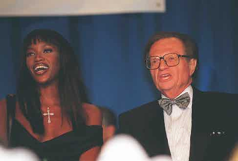 With Naomi Campbell at the National Italian American Foundation gala, 1997 (Photo By Karin Cooper/Getty Images)