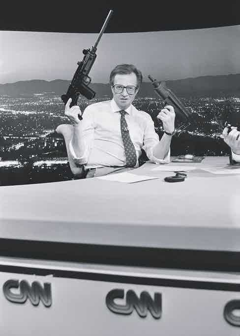 Larry King compares a real and toy Uzi in a segment on gun control (Photo via Getty)