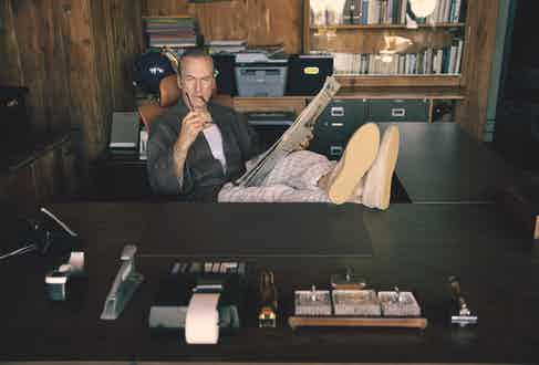 Check robe and cream-striped pyjama pants, Gucci; camel furry slippers, Jimmy Choo; tiger stone signet ring, David Yurman; reading glasses, Jacques Marie Mage. Watch and wedding ring, property of Bob Odenkirk.