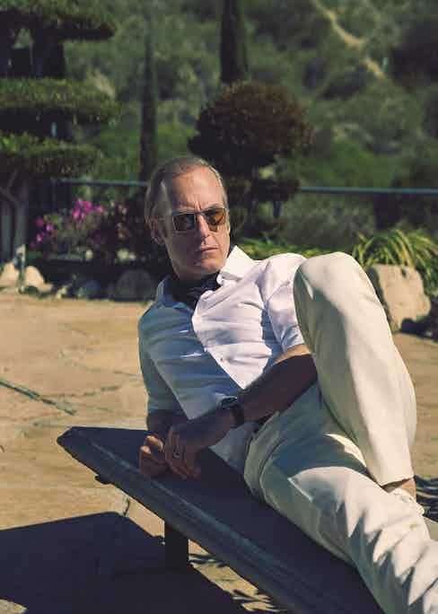 Ivory linen jacket, matching trousers and white cotton shirt, Brioni; white sneakers, Dolce & Gabbana; sunglasses, Jacques Marie Mage. Watch and wedding ring, property of Bob Odenkirk. Black spot silk scarf and black belt, stylist's own.