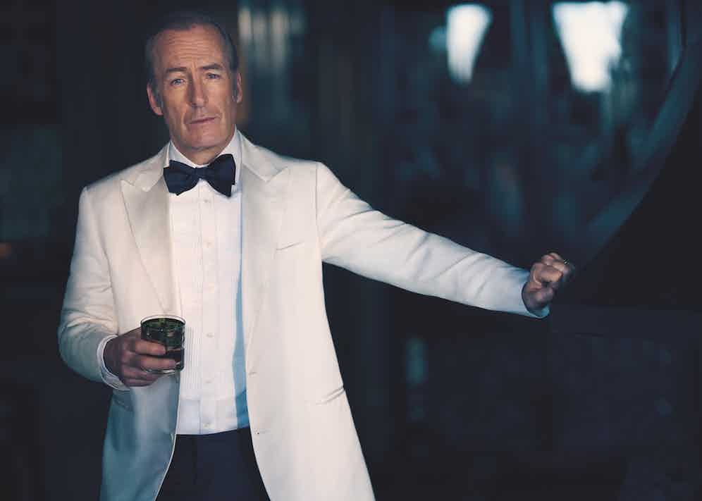 Ivory tuxedo jacket, black evening trousers, white evening shirt and black silk bow-tie, Brunello Cucinelli; knotted cufflinks, David Yurman.