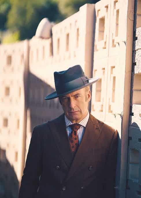 Brown pinstriped jacket, pants, white/brown stripe shirt and brown paisley tie, Lardini; grey bash fedora, Nick Fouquet.