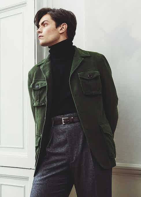 Green moleskin four-pocket jacket, New & Lingwood; black wool cashmere blend roll-neck, Anderson & Sheppard; charcoal grey flannel Hollywood-top trousers, Edward Sexton at The Rake; belt, property of The Rake.