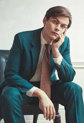 Green hopsack suit, Richard Anderson; ivory poplin cotton shirt, Favourbrook; orange silk mini paisley Madder tie, Budd Shirtmakers; dark Oak antique calf Lambourne boot, Edward Green.