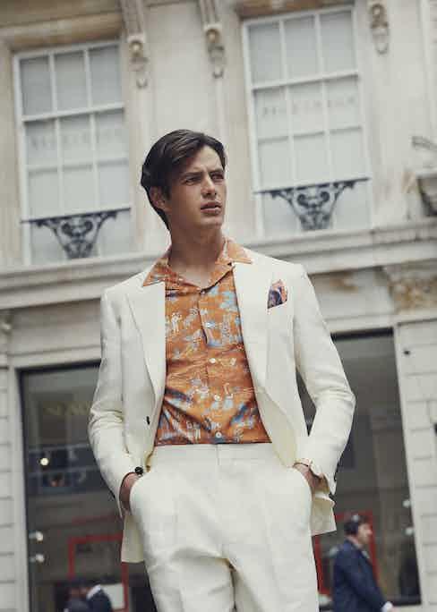 Ivory linen jacket and trousers. Shirt by Barbanera, pocket square by Edward Sexton. Shot at Davidoff of London.