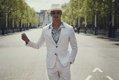 Off-white gabardine jacket and trousers. Hat by Anderson & Sheppard, shirt by Barbanera, sunglasses by Curry & Paxton.