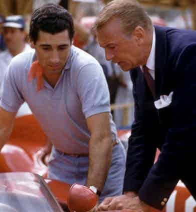 """Alfonso """"Marquis"""" de Portago talks with actor Gary Cooper at the Grand Prix of Cuba, Havana, 1957 (Photo by Hy Peskin/Getty Images)"""