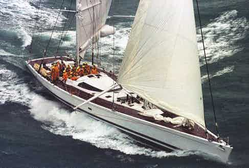 His record-breaking yacht, Mari Cha III crosses the line at Lizard's Point in 1998