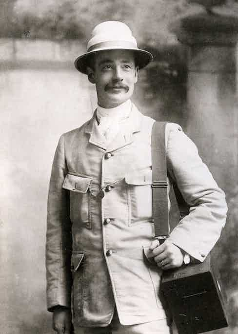 English photographer Horace Nicholls covered the Boer War and is seen here wearing an early incarnation of the safari jacket, artfully paired with a pocket watch across both chest pockets, circa 1900.