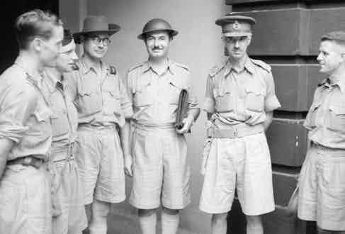 British soldiers stationed in Malaya, wearing lightweight Khaki Drill uniforms in 1942.